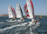 Dynamic racing dinghies sailing away