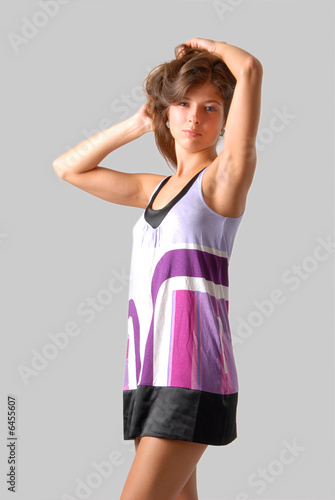 poster of girl in black and violet dress is combing her long hair