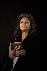 Woman Eyes Closed with Bible