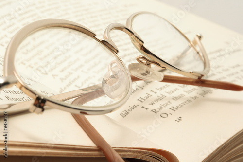 Eyeglasses on the Shakespare's book