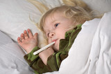 sick child in bed under blanket with thermometer in mouth poster