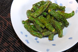 Image of a bowl of spicy japanese fried green peppers poster