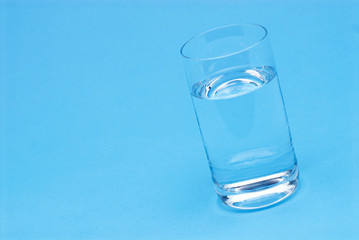 Glass of water isolated on blue background