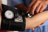 Medical worker checking blood pressure poster