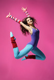 Fototapety cool girl jumping on the magenta background