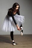 The dancer in a white skirt dresses slipper poster