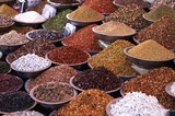 Indian Market Stall Selling Spices and Pulses poster