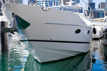 A moored luxury boat in a marina
