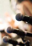 Fototapety Microphone on abstract blurred background (shallow DoF)