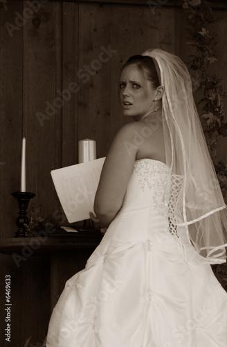 A nervous bride prepares for the wedding ceremony. Sepia Tones