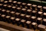 Isolated old dusty typewriter keyboard. author copyright concept poster