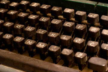 Isolated old dusty typewriter keyboard. author copyright concept
