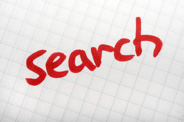 Red word SEARCH on paper. Hand writing font and internet concept