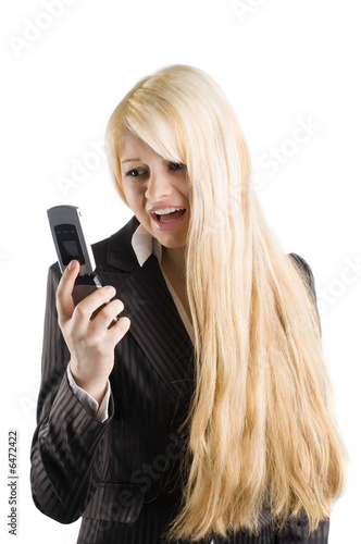 cute blond woman in formal dress screaming with her mobile