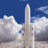 Spaceship against the cloudy sky background