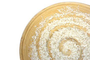Thai jasmine rice on bamboo plate close-up. Isolated over white