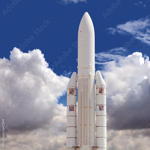 Leinwandbild Motiv Spaceship against the cloudy sky background