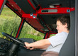 Young boy pretending to drive a fire truck