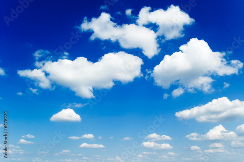 poster of Beautiful white fluffy clouds in the blue sky