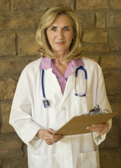 Female Doctor holding clipboard with patients records