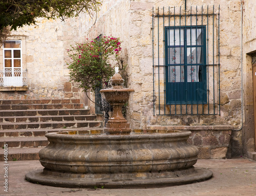 Small Courtyard Plaza Fountain end Walking Street Morelia Mexico