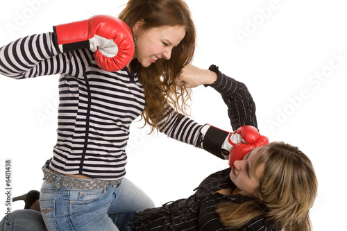 two boxing women isolated on a white background