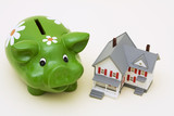 Home with piggy bank – he costs of a mortgage poster