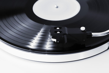 Vinyl player, focus on the needle, the record is spinning.