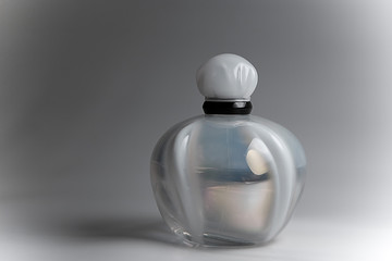 Close up of perfume bottle on  background