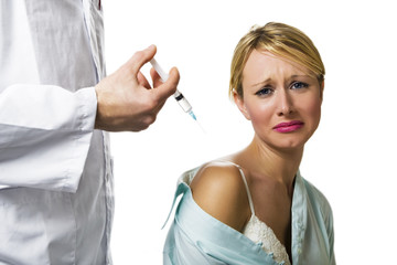healthcare and medicine: young woman scared of injections