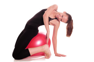 A young girl exercise with ball rollout