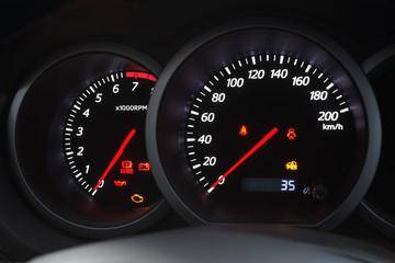 Closeup shot of a speedometer and tachometer of a modern car.