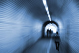 Surreal composition of blurred people inside tunnel poster
