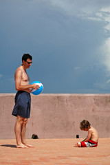 father and son with ball