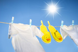 White t-shirts and slippers on the clothesline poster