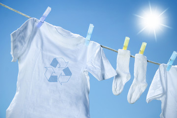 Eco friendly  laundry drying on clothes line against a blue sky