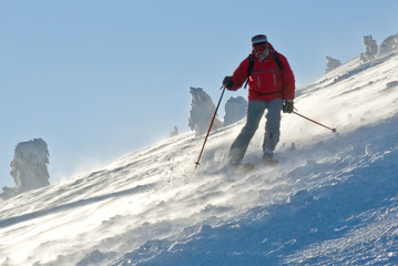 skier freeride from mountain during snow storm