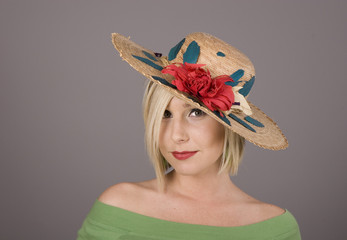 Blonde Flowered Hat One Eye
