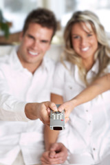 love couple with TV remote control