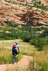 Mountain biker begins a difficult trail