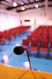 A microphone in an empty auditorium