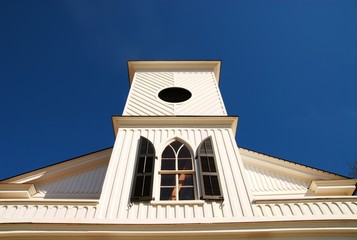 Front steeple of an old church building.