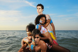 Multiracial team on the beach poster