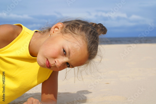 Preteen girl on beach