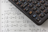 Scientific calculator on a math textbook  poster