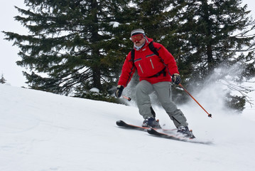skier moving down hill at high speed
