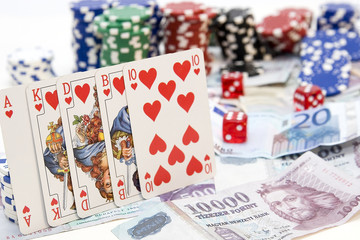 Poker hands - cards have focus with poker chips and money