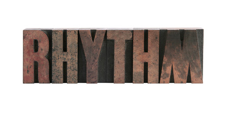 the word 'rhythm' in wood letters