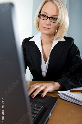 Young business woman typing