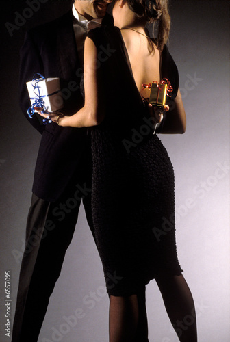 Young couple exchanging presents during a dance 02